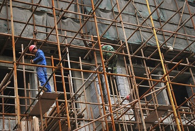 Worker on Metal Scaffold